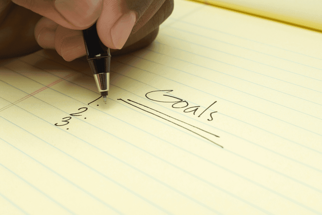 Hand writing goals on paper