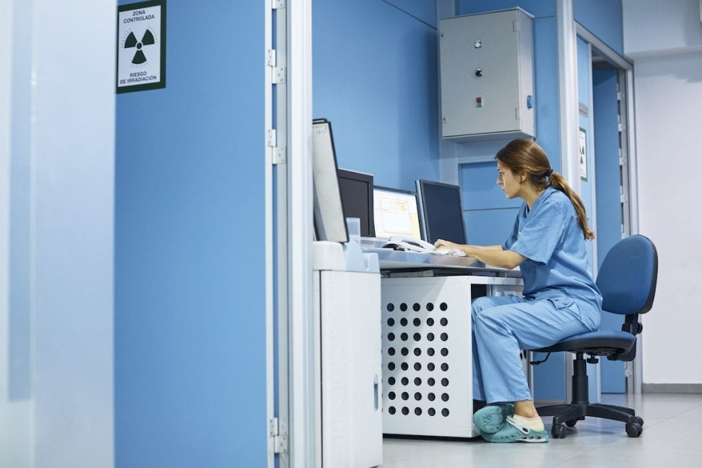 Veterinarian using computer at desk in clinic