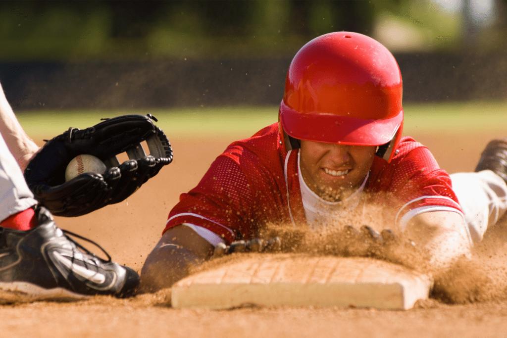 Baseball player sliding onto base