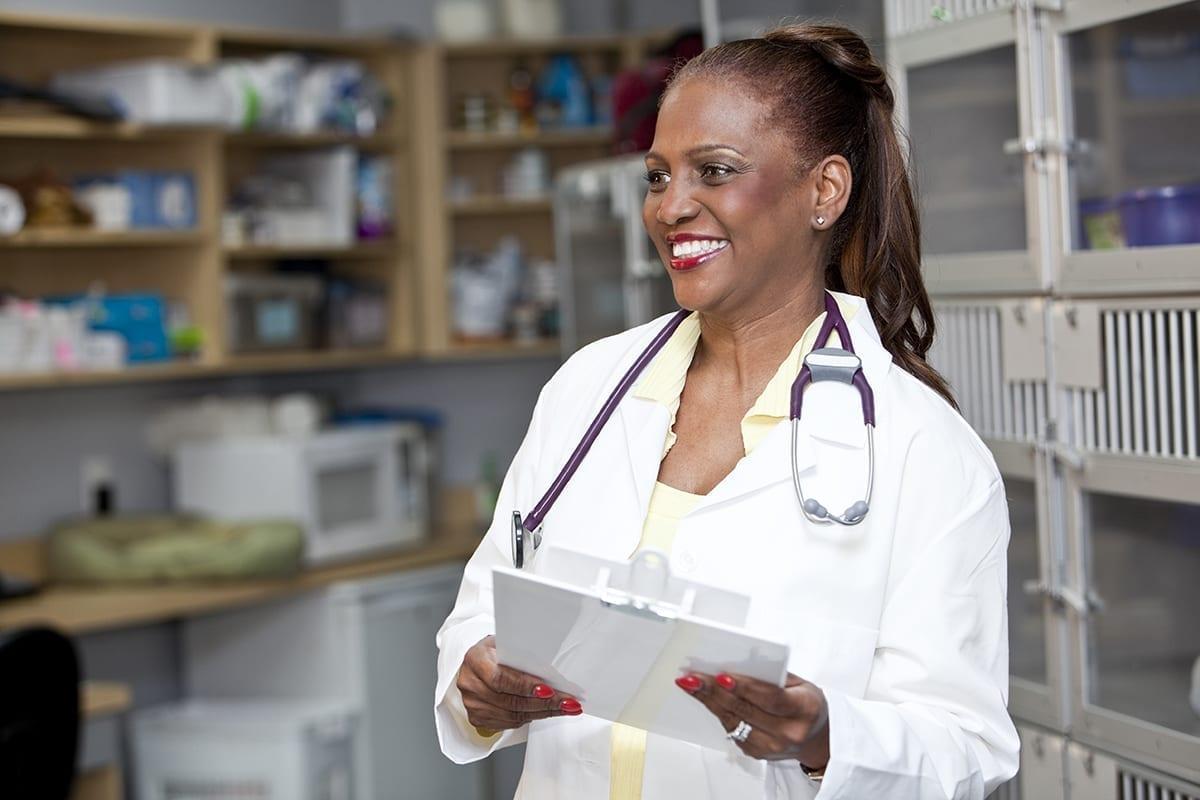Female veterinarian holding clipboard