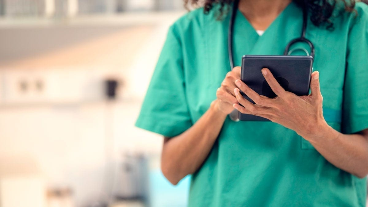 Female veterinarian typing on tablet