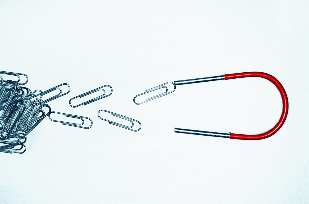 Magnet attracting paperclips