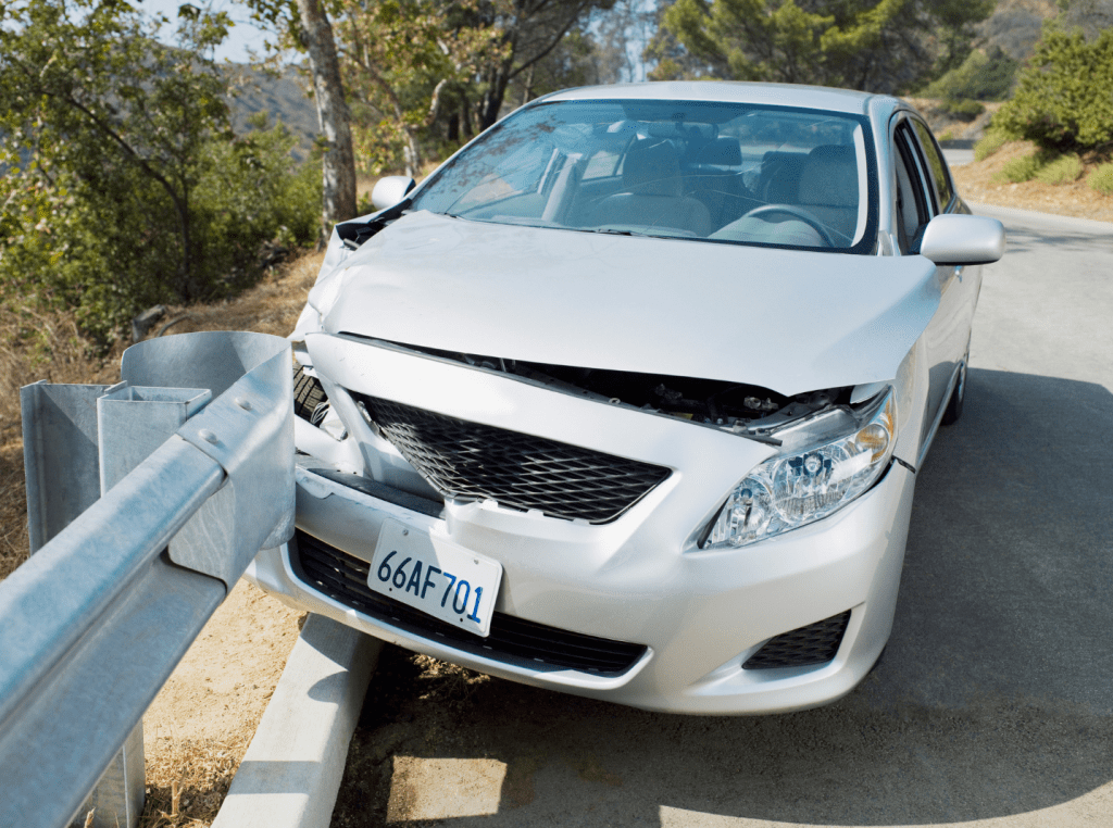Small silver car crashed into guardrail