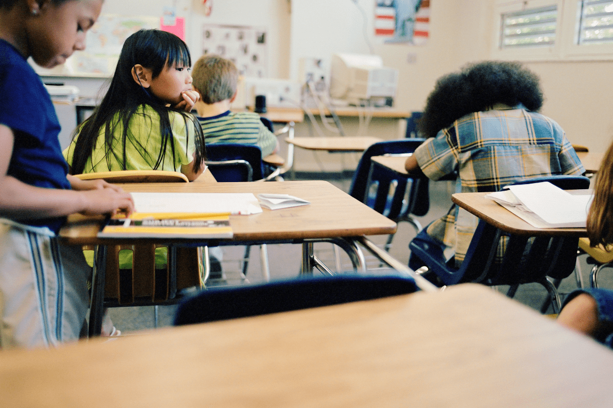 children sitting at school desks