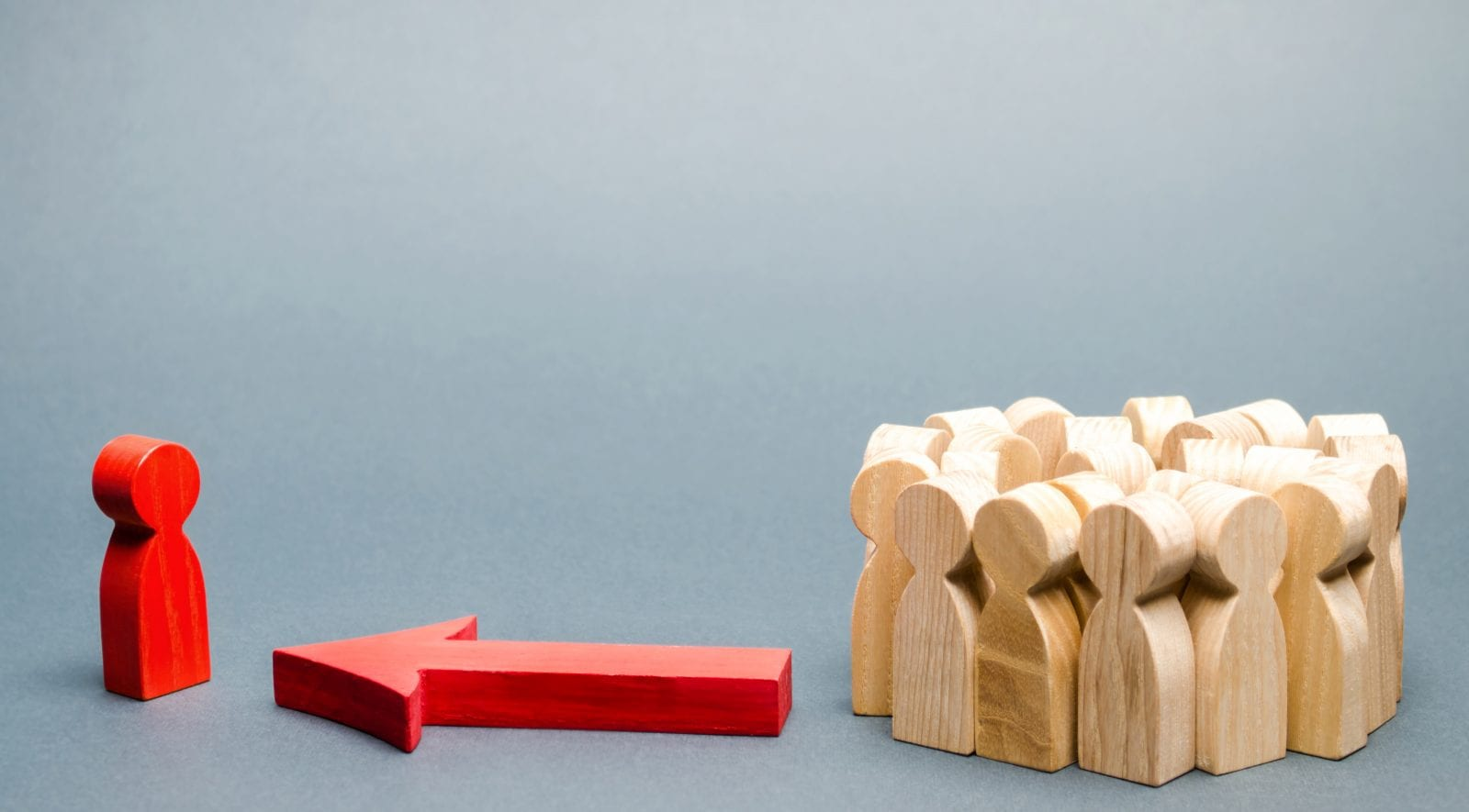 wooden peg people and arrow
