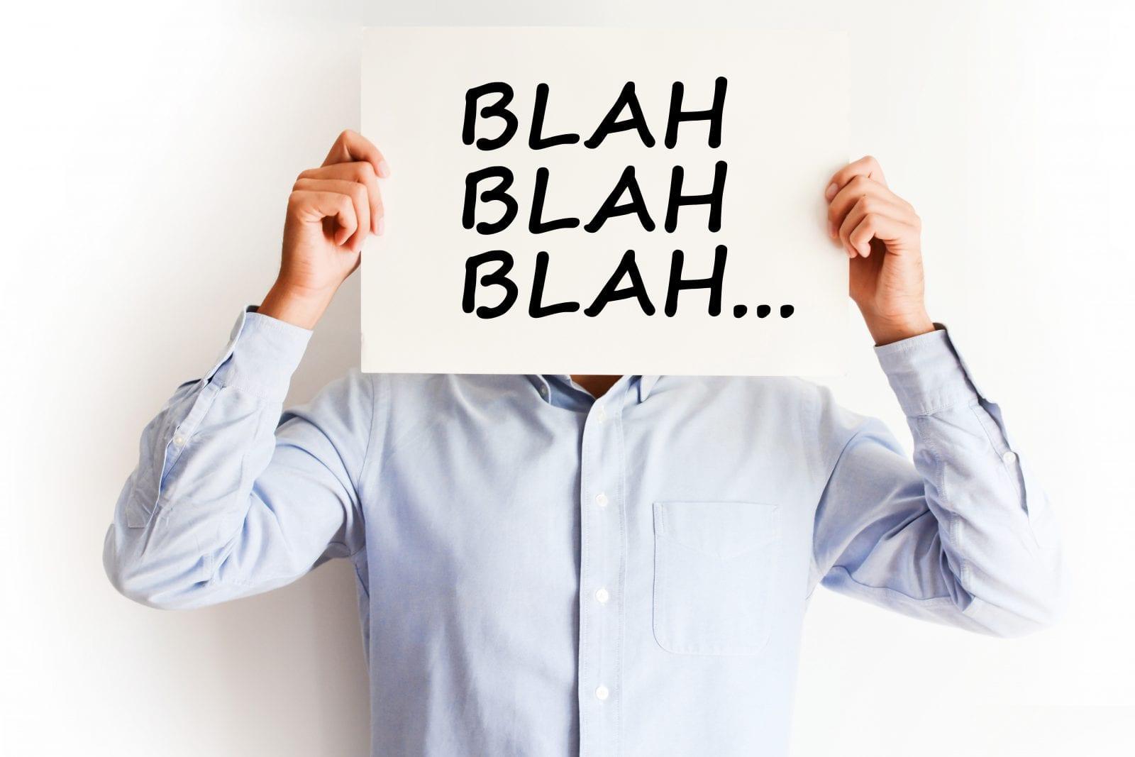 Man holding blah blah blah sign
